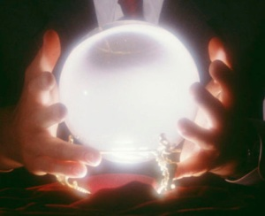 two hands holding a glowing crystal ball